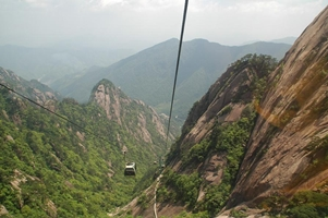 A view down a long ravine along a gondola (cable car) cable in Huangshan (黄山, Yellow Mountain), China