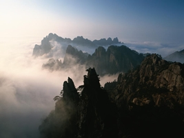 A sea of clouds floats among the many peaks of Huangshan (黄山, Yellow Mountain), China