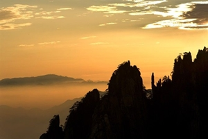 Karst peaks silhouetted against a dusky sky at Huangshan (黄山, Yellow Mountain), China