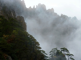 A mountain ridge is concealed by the mist at Huangshan (黄山, Yellow Mountain), China