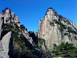 Peaks and pine trees against a vivid blue sky at Huangshan (黄山, Yellow Mountain), China