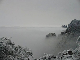 The sea of clouds and snow-covered mountain scenery of Huangshan (Yellow Mountain), China, in winter