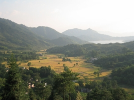 A fertile valley and distant lake in the Huangshan (黄山, Yellow Mountain) area of China