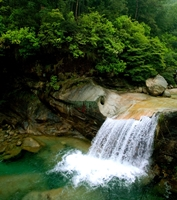 A picturesque waterfall in the Huangshan (黄山, Yellow Mountain) area of China