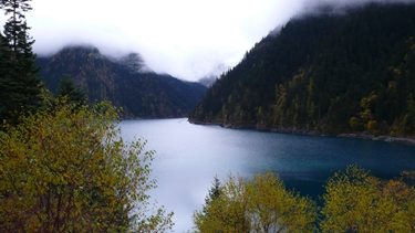 Misty mountains surround Long Lake in Jiuzhaigou (九寨沟), Sichuan Province, China