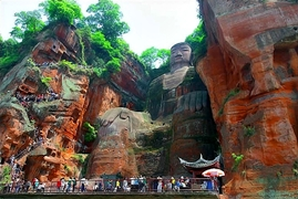 The Leshan Giant Buddha (乐山大佛), carved from a cliff on the Min River (Min Jiang) in Sichuan Province, China