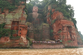 A view of the Leshan Giant Buddha (乐山大佛) from a boat on the Min River (Min Jiang) in Sichuan Province, China