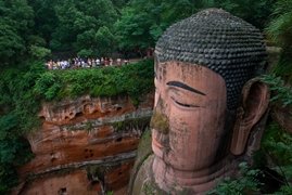 The head of the Leshan Giant Buddha (乐山大佛) in Sichuan Province, China, dwarfs a nearby group of tourists