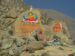 Colorfully painted rocks and prayer flags outside Drepung Monastery (哲蚌寺) in Lhasa (拉萨), Tibet, China