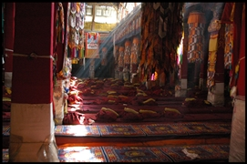 Rays of sunlight slant into a colorfully decorated prayer hall at Drepung Monastery (哲蚌寺) in Lhasa (拉萨), Tibet, China
