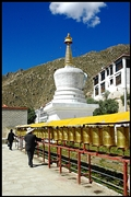 Prayer wheels and a large white stupa at Drepung Monastery (哲蚌寺) in Lhasa (拉萨), Tibet, China