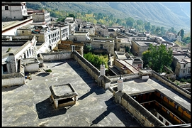 A view downward onto the rooftops of the buildings of Drepung Monastery (哲蚌寺) in Lhasa (拉萨), Tibet, China