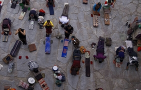 Prostrate pilgrims at the entrance to Jokhang Temple (大昭寺) in Lhasa (拉萨), Tibet, China