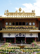 Colorful potted flowers and gold rooftop ornaments adorn Norbulingka (罗布林卡) in Lhasa (拉萨), Tibet, China
