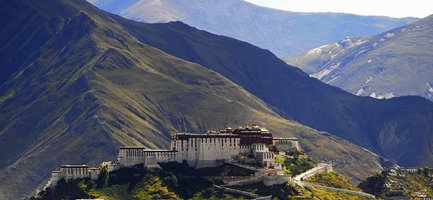 Enormous mountains rise behind Potala Palace (布达拉宫) in Lhasa (拉萨), Tibet, China
