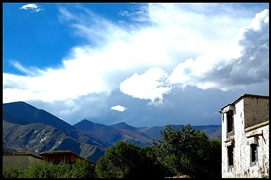 A view of mountains, blue sky, and clouds from Sera Monastery (色拉寺) in Lhasa (拉萨), Tibet, China