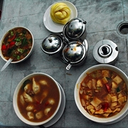 Tibetan dishes: tingmo (steamed bread), thenthuk (noodle soup), momos