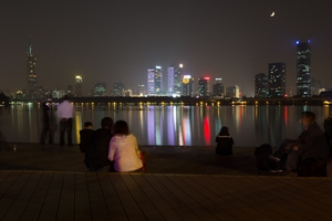 Brightly lit buildings reflect off the surface of Xuanwu Lake in downtown Nanjing