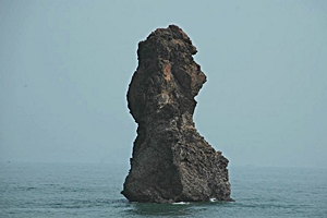 The 'Old Man of Stone,' a natural rock formation in the sea near Qingdao (青岛), China