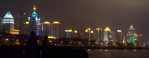 Brightly lit buildings along the waterfront in Qingdao (青岛), China