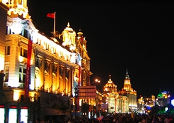 A closeup of the brightly lit colonial buildings of the Bund in Shanghai, China
