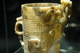 An ancient, intricately carved jade cup on display at the Shanghai Museum in Shanghai, China