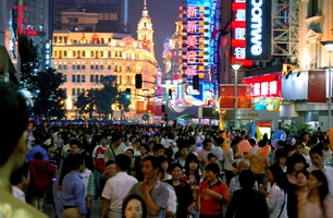 A sea of shoppers and neon signs on a pedestrian street section of Nanjing Road