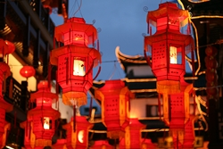 Traditional Chinese red paper lanterns hanging in the Temple of the Town Gods Shopping Center in the Old Street area of Shanghai, China
