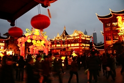 A crowded, brightly lit square in the Temple of the Town Gods Shopping Center in the Old Street area of Shanghai, China