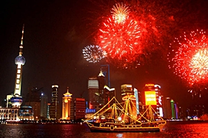 view from the Bund of Chinese New Year fireworks exploding over the Huangpu River and Pudong in Shanghai, China