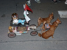 three toy dogs pulling a cat in a patriotic chariot during Expo 2010 in Shanghai, China