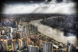 View from Pudong's Jinmao Tower of numerous tall buildings lining the Huangpu River in Shanghai, China