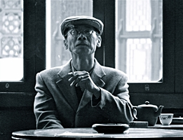 A smoking man in the Huxinting Tea House in Shanghai, China
