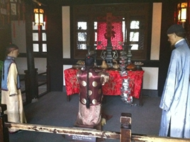 A wax figure display of a Confucian ritual at the Former Residence of Lu Xun in Shaoxing