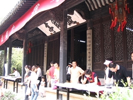 Visitors practicing calligraphy at Orchid Pavilion (兰亭 or Lan Ting) in Shaoxing