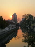 The sun sets over a canal in Shaoxing, China