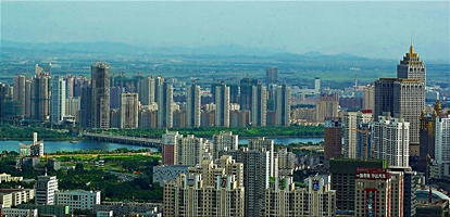 Residential towers line the Hun River in downtown Shenyang (沈阳), China