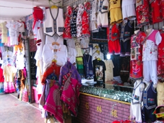 A stall selling clothing in the style of Yunnan's ethnic minorities