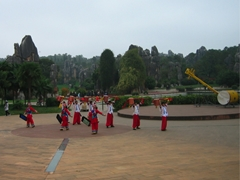 Performers from the Yi minority ethnic group sing and dance at Yunnan's Stone Forest