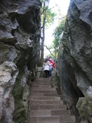 A stairway climbing between high stone walls in Yunnan's Stone Forest