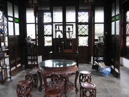 Traditional mahogany furniture and decor at the Humble Administrator's Garden in Suzhou (苏州), China