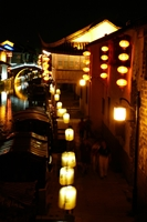 Traditional lanterns illuminate a narrow lane along a canal at Shantang Street in Suzhou (苏州), China