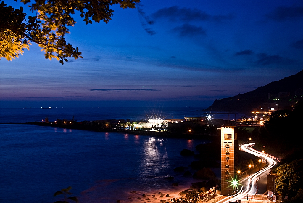 A night view of the shoreline at Sizih Bay near Kaohsiung, Taiwan