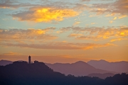 A pagoda on a hill against a sunset-painted sky at Sun Moon Lake, Taiwan