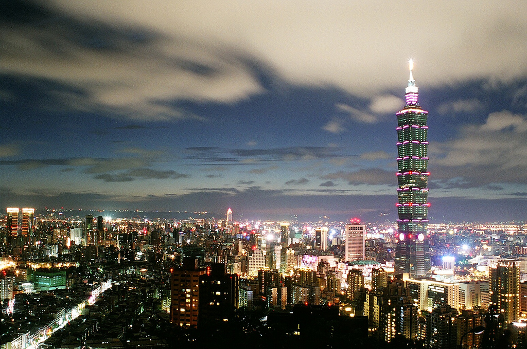 The skyline of Taipei at night, including Taipei 101