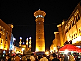 A minaret towers over a bazaar in Ürümqi, China