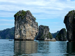 Limestone islets rise high above the water in Ha Long Bay, Vietnam