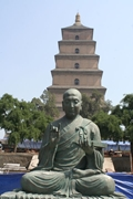 A statue of a meditating Buddha with Big Goose Pagoda in the background, Xi'an (西安), China