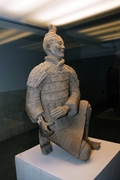 A kneeling terracotta archer on display at the tomb of the First Emperor near Xi'an (西安), China