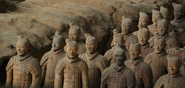 A closeup of rows of terracotta soldiers at the tomb of the First Emperor in Xi'an (西安), China